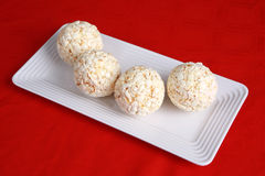 Popcorn balls on a red background Royalty Free Stock Photo
