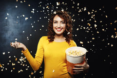 Popcorn battle. Frineds having fun at home party throwing popcorn. Popcorn battle. Popcorn shower. Frineds having fun at home party throwing popcorn to each Royalty Free Stock Image