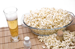 Popcorn and beer. Popcorn, salt, toothpicks and beer om a white background Royalty Free Stock Images