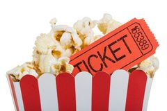 Popcorn in big box with movie tickets, isolated on white. Stock Photos