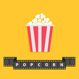 Popcorn. Big film strip ribbon line with text. Red white box. Cinema movie night icon in flat design style. Yellow background. Vector illustration Royalty Free Stock Photography