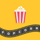Popcorn. Big film strip wave ribbon line with text. Red white box. Cinema movie night icon in flat design style. Yellow background Royalty Free Stock Photo