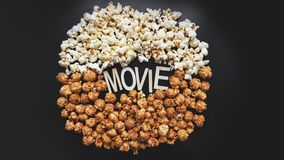 Popcorn on black background. Watching a movie with popcorn. Copy space. Pop corn. Top view. Flat lay. Wooden letters movie stock photos