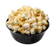 Popcorn in a black cup, isolated Royalty Free Stock Photography