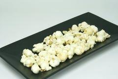 Popcorn on black dish Royalty Free Stock Photo