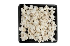 Popcorn on black plate Stock Image