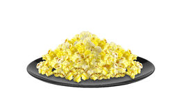 Popcorn on black plate isolated on white Royalty Free Stock Photo