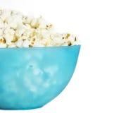 Popcorn. Blue plastic bowl on white background Royalty Free Stock Photo