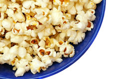 Popcorn in a blue plate isolated closeup Stock Photos