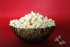 Popcorn bowl. Isolated on red Royalty Free Stock Image