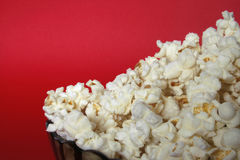 Popcorn bowl. Isolated on red Royalty Free Stock Photos