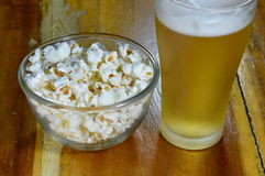 Popcorn in bowl and beer Royalty Free Stock Photo