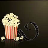 Popcorn bowl, film strip. Cinema attributes. Detailed vector illustration Stock Photography