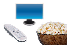 Popcorn bowl remote control and a screen Royalty Free Stock Photography