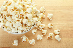 Popcorn bowl on table Stock Image