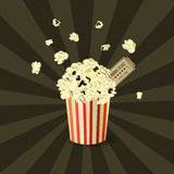 Popcorn bowl and ticket. On retro background blowup Royalty Free Stock Image