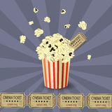 Popcorn bowl and ticket. On retro background blowup Royalty Free Stock Photography
