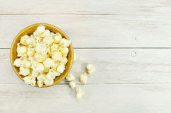 Popcorn in bowl on wood table. Popcorn in bowl on white  wood table Stock Images