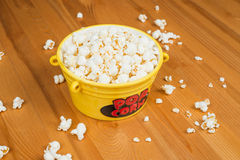 Popcorn. A bowl of popcorn on a wooden table Stock Photography
