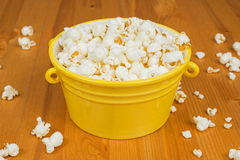 Popcorn. A bowl of popcorn on a wooden table Stock Photos