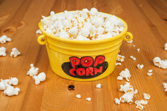 Popcorn. A bowl of popcorn on a wooden table Royalty Free Stock Photos