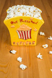Popcorn. A bowl of popcorn on a wooden table Royalty Free Stock Photo