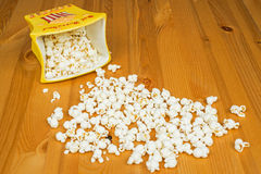 Popcorn. A bowl of popcorn on a wooden table Royalty Free Stock Image