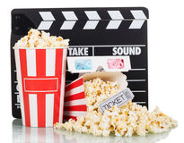 Popcorn box with clapper board and 3d movie glasses on white Stock Photography