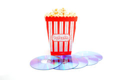 Popcorn in box with DVD disk Royalty Free Stock Image