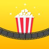 Popcorn box. Film strip rounded. Movie Cinema icon in flat design style. Pop corn icon. Yellow gradient background. Shining stars. Vector illustration Stock Photo