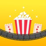 Popcorn box. Film strip rounded. Two tickets admit one. Cinema icon set in flat design style. Pop corn icon. Yellow gradient backg. Round. Shining stars. Vector Stock Photos