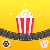 Popcorn box. Film strip. Two tickets admit one. Movie reel Cinema icon set in flat design style. Pop corn icon. Yellow gradient ba. Ckground. Shining stars Stock Photography