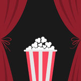 Popcorn box. Open luxury red silk stage theatre curtain. Velvet scarlet curtains with bow. Fast food. Flat design. Movie cinema pr Stock Photography