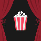 Popcorn box. Open luxury red silk stage theatre curtain. Velvet scarlet curtains with bow. Fast food. Flat design. Movie night cin Stock Image