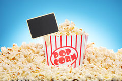 Popcorn in box overflowing with freshly popped corn Stock Photos