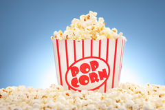 Popcorn in box overflowing with freshly popped corn Stock Image
