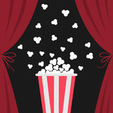 Popcorn box popping. Open luxury red silk stage theatre curtain. Velvet scarlet curtains with bow. Fast food. Flat design. Movie c Royalty Free Stock Images