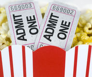 Popcorn in box and two tickets. Close up shot of popcorn in box and two tickets Stock Image