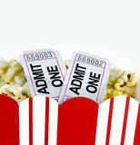 Popcorn in box and two tickets. With space for text on white background Royalty Free Stock Photos