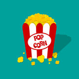 Popcorn box vector icon. Opened Red white paper box with popcorn. Popcorn logo. vector illustration in flat design on green background Stock Images
