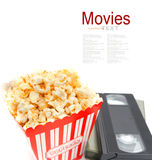 Popcorn in box and Video Cassette Stock Images