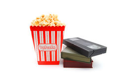 Popcorn in box and Video Cassette Royalty Free Stock Photography