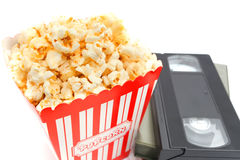 Popcorn in box and Video Cassette. On white background stock photo