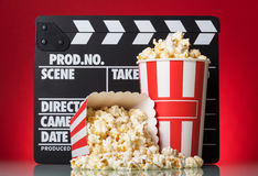 Popcorn boxes with clapper board on a red Royalty Free Stock Image