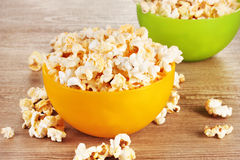 Popcorn in bright plastic bowls Stock Image