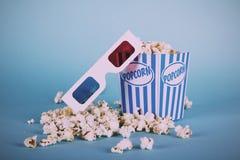 Popcorn Bucket Against A Blue Background Vintage Retro Filter. Stock Images
