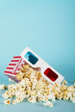 Popcorn bucket against a blue background Stock Images