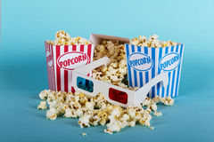 Popcorn bucket against a blue background Royalty Free Stock Photo