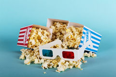 Popcorn bucket against a blue background Stock Photo
