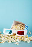 Popcorn bucket against a blue background Stock Photos